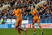 Wolverhampton Wanderers striker Benik Afobe  gesticulates to the Sheffield Wednesday fans after scoring  during the Sky Bet Championship match between Sheffield Wednesday and Wolverhampton Wanderers at Hillsborough, Sheffield, England on 20 December 2015. Photo by Simon Davies.