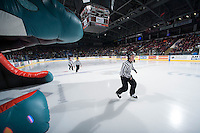 KELOWNA, CANADA - JANUARY 10: Junior officials enter the ice at the Kelowna Rockets on January 10, 2015 at Prospera Place in Kelowna, British Columbia, Canada.  (Photo by Marissa Baecker/Shoot the Breeze)  *** Local Caption ***