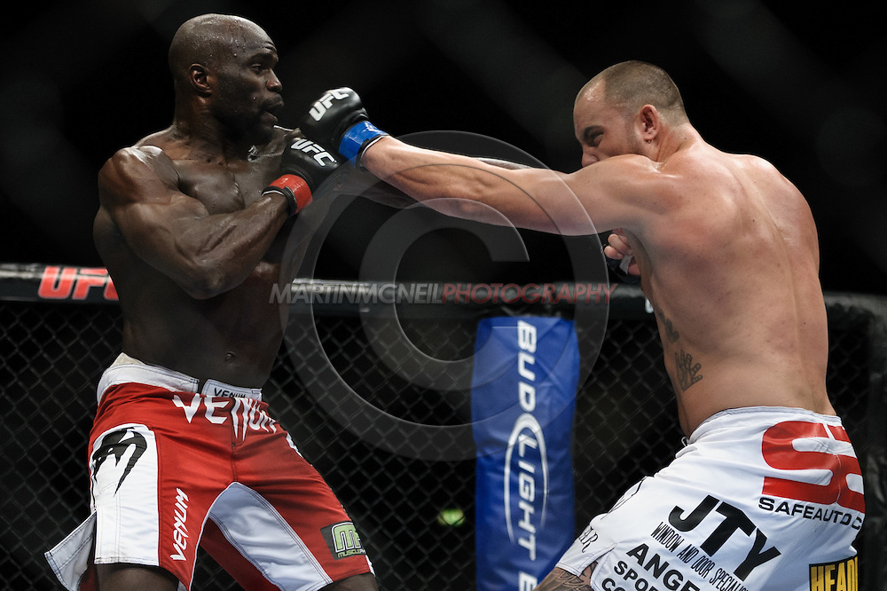 """LONDON, ENGLAND, OCTOBER 2010: Cheick Kongo (left) and Travis Browne trade blows during """"UFC 120: Bisping vs. Akiyama"""" inside the O2 Arena in Greenwich, London"""