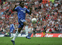 Photo: Lee Earle.<br /> Chelsea v Manchester United. The FA Cup Final. 19/05/2007.Chelsea's Didier Drogba scores in extra time.