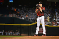 PHOENIX, AZ - JULY 26:  Patrick Corbin #46 of the Arizona Diamondbacks prepares to deliver a pitch in the first inning of the game against the Atlanta Braves at Chase Field on July 26, 2017 in Phoenix, Arizona.  (Photo by Jennifer Stewart/Getty Images)