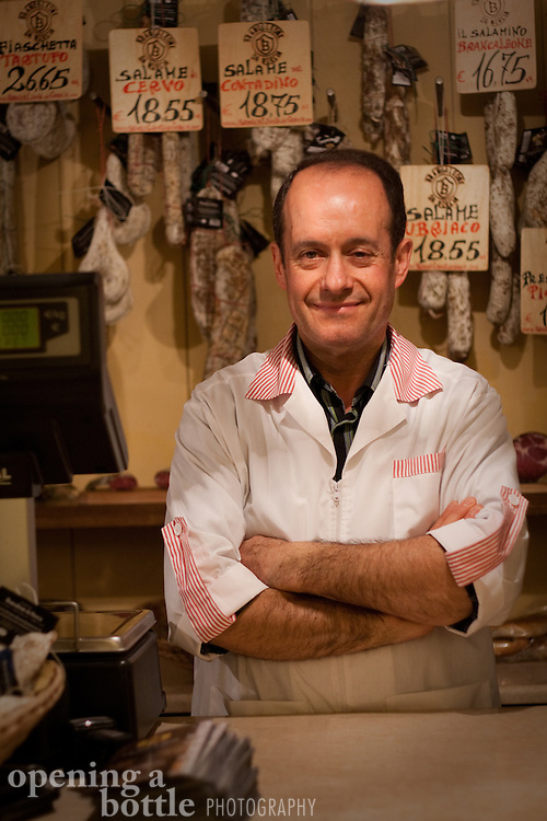 "A butcher proudly poses in front of his cured meat products (salami, prosciutto, etc.) in a ""norceria"" in Assisi, Umbria, Italy. For editorial use only."