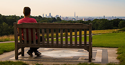 Hampstead Heath, London, July 20th 2016. A man enjoys a view of the City from Hampstead Heath in North London as the city wakes up to another warm summer's day. &copy;Paul Davey<br /> FOR LICENCING CONTACT: Paul Davey +44 (0) 7966 016 296 paul@pauldaveycreative.co.uk