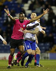 Gabriel Zakuani of Peterborough United battles with Bury's Peter Clarke - Mandatory byline: Joe Dent/JMP - 01/03/2016 - FOOTBALL - Gigg Lane - Bury, England - Bury United v Peterborough United - Sky Bet League One