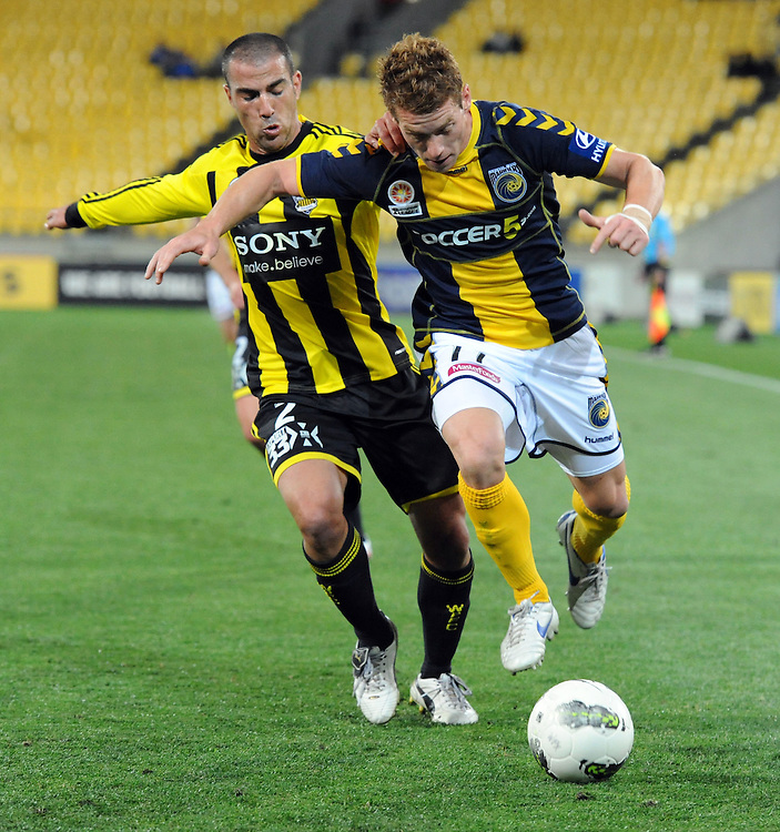 Central Coast Mariners Oliver Bozanic, right contests the ball with Phoenix's Manny Muscat in the A-League football match at Westpac Stadium, Wellington, New Zealand, Friday, November 04, 2011. Credit:SNPA / Ross Setford