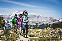 Backpackers Chris Call, Kaitlyn Honnold, and ALexa Ault head out of the Wind River Range, Wyoming.