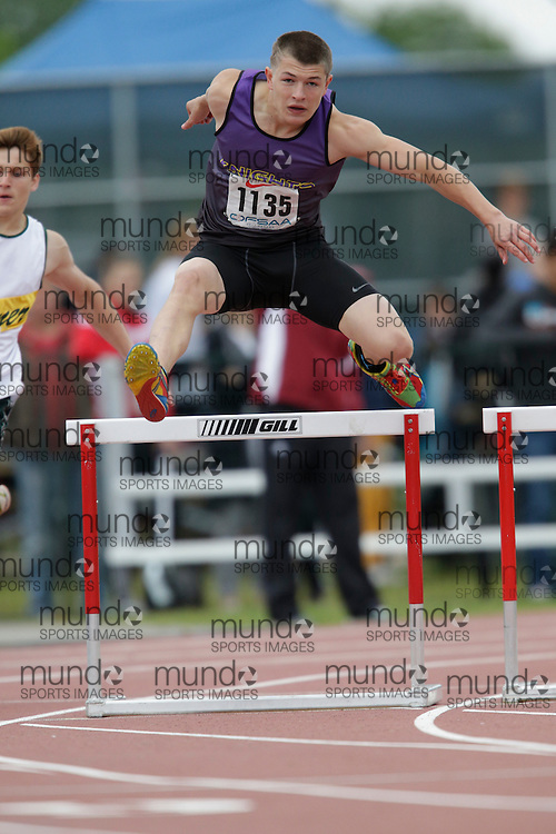 Pierce Wallingford of Lo-Ellen Park SS - Sudbury competes in the intermediate hurdle heats at the 2013 OFSAA Track and Field Championship in Oshawa Ontario, Saturday,  June 8, 2013.<br /> Mundo Sport Images/ Geoff Robins