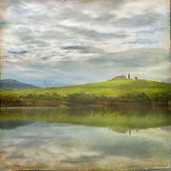 Distressed, painterly rendition of a Tuscan hill reflection under a brooding sky