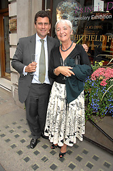 TREVOR PICKETT and LIZZIE FARGHER at a reception to celebrate the launch of Prince Dimitri of Yugoslavia's one-of-a-kind jeweleery collection held at Partridge Fine Art, 144-146 New Bond Street, London on 11th June 2008.<br />
