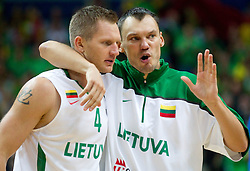 Rimantas Kaukenas of Lithuania and Sarunas Jasikevicius of Lithuania during basketball game between National basketball teams of Lithuania and France at FIBA Europe Eurobasket Lithuania 2011, on September 9, 2011, in Siemens Arena,  Vilnius, Lithuania.  (Photo by Vid Ponikvar / Sportida)
