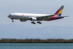 Asiana Airlines Boeing 777-28EER (HL7700) lands at San Francisco International Airport (SFO), Millbrae, California, United States of America