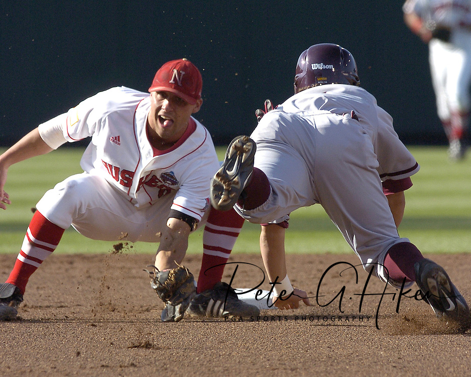 Nebraska shortstop Joe Simokaitis (L) gets ready to put the tag on Arozona State's Jeff Larish (R) trying to steal second base in the top of the first inning.  Nebraska defeated Arizona State in the first round of the College World Series 5-3 at Rosenblatt Stadium in Omaha, Nebraska on June 17, 2005.
