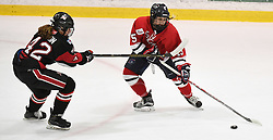 MOON TOWNSHIP, PA - SEPTEMBER 23:  Maeve Garvey #15 of the Robert Morris Colonials handles the puck while being defended by Claire Dalton #42 of the Toronto Jr. Aeros in the first period during the game at the 84 Lumber Arena on September 23, 2016 in Moon Township, Pennsylvania. (Photo by Justin Berl)