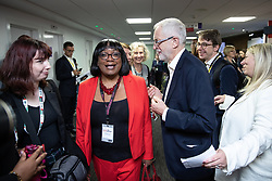 © Licensed to London News Pictures . 22/09/2019. Brighton, UK. Labour leader JEREMY CORBYN passes DIANE ABBOTT as he walks through the exhibition at the conference , during the second day of the 2019 Labour Party Conference at the Brighton Centre . Photo credit: Joel Goodman/LNP