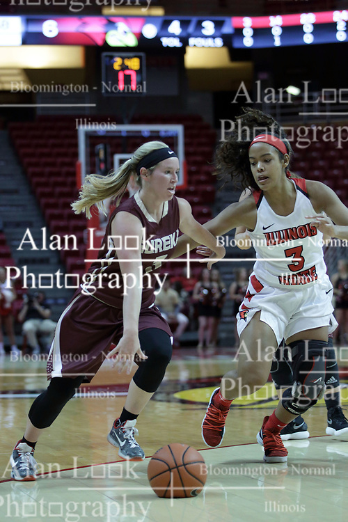 01 November 2017: Kennedy Dura heads up the lane guarded by Ajai Simmons during a Exhibition College Women's Basketball game between Illinois State University Redbirds the Red Devils of Eureka College at Redbird Arena in Normal Illinois.