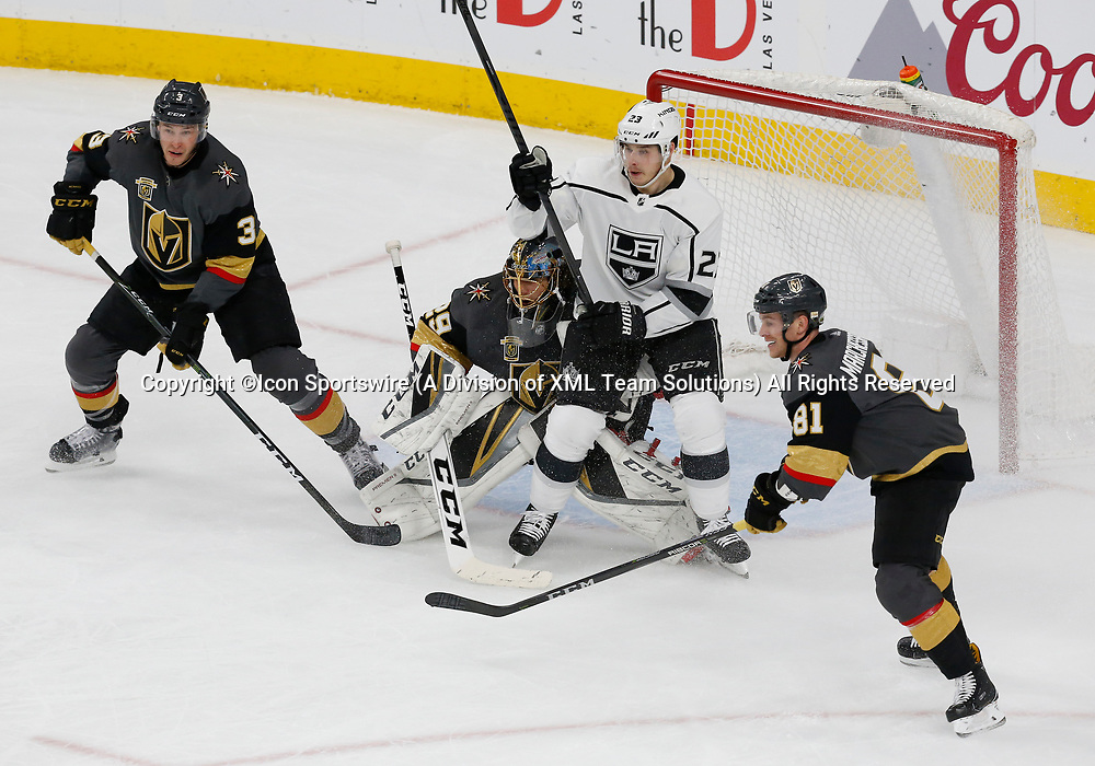 LAS VEGAS, NV - APRIL 11: Vegas Golden Knights defenseman Brayden McNabb (3), goaltender Marc-Andre Fleury (29) and center Jonathan Marchessault (81) guard the goal against Los Angeles Kings right wing Dustin Brown (23) during Game One of the Western Conference First Round of the 2018 NHL Stanley Cup Playoffs between the L.A. Kings and the Vegas Golden Knights Wednesday, April 11, 2018, at T-Mobile Arena in Las Vegas, Nevada. The Golden Knights won 1-0.  (Photo by: Marc Sanchez/Icon Sportswire)