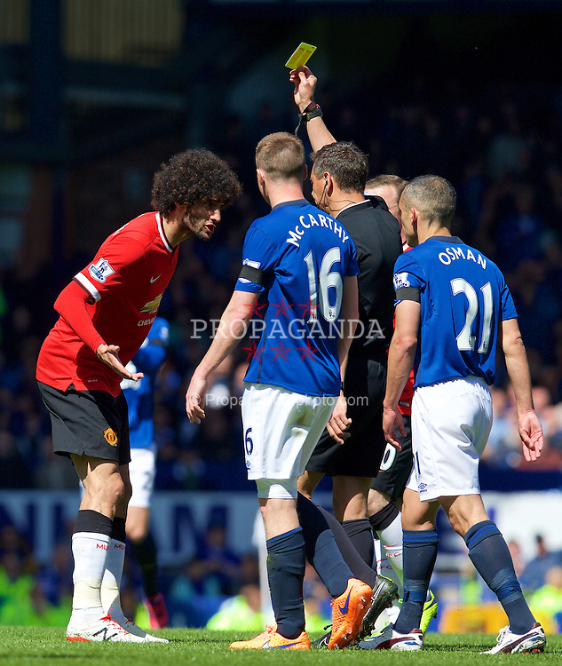 LIVERPOOL, ENGLAND - Sunday, April 26, 2015: Manchester United's Marouane Fellaini is shown a yellow card by referee Andre Marriner after a foul against Everton's Ross Barkley during the Premier League match at Goodison Park. (Pic by David Rawcliffe/Propaganda)