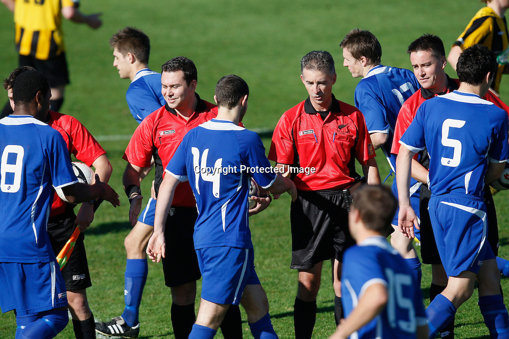 The teams shake hands with referee Nick Waldron and his assistants before kick off. Chatham Cup Quarterfinal, East Coast Bays v Glenfield Rovers, Bays City Park, Auckland, Saturday 24th July 2010. Photo: Shane Wenzlick/PHOTOSPORT