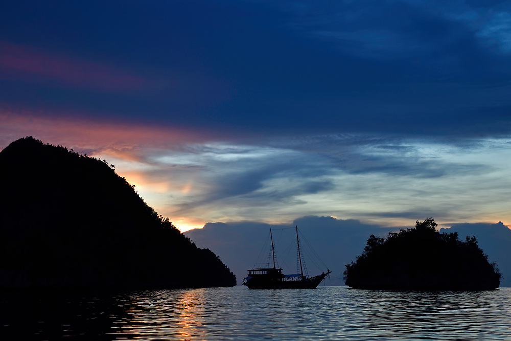 """The ship Cahaya Mandiri, Karst landscapes in Waiag archipelago, Raja Ampat, Western Papua, Indonesian controlled New Guinea, on then Science et Images """"Expedition Papua, in the footsteps of Wallace"""", by Iris Foundation"""