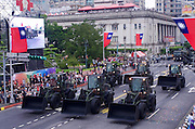 Front end loaders used for disaster relief take part in the Republic of China (Taiwan) National Day celebration on October 10, in front of the Presidential Palace in Taipei.<br />