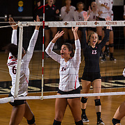 09 November 2017:  The San Diego State Aztecs women's volleyball team hosts UNLV Thursday night at Peterson Gym. San Diego State defensive specialist Gabi Peoples (11) and San Diego State middle blocker Baylee Little (16) celebrate after winning a point against UNLV. The Aztecs won 3-1 (25-18; 16-25; 25-12; 25-13).<br /> www.sdsuaztecphotos.com