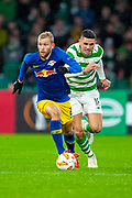 Marcel Halstenberg (#23) of RB Leipzig breaks clear of Tom Rogic (#18) of Celtic FC during the Europa League group stage match between Celtic and RP Leipzig at Celtic Park, Glasgow, Scotland on 8 November 2018.