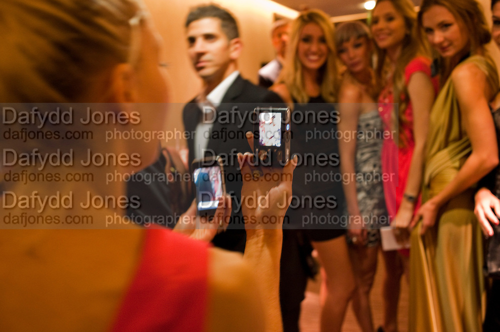 ANNETTA PERCHEL TAKING PICTURES WITH PHONES, The London Bar and Club awards. Intercontinental Hotel. Park Lane, London. 6 June 2011. <br /> <br />  , -DO NOT ARCHIVE-© Copyright Photograph by Dafydd Jones. 248 Clapham Rd. London SW9 0PZ. Tel 0207 820 0771. www.dafjones.com.