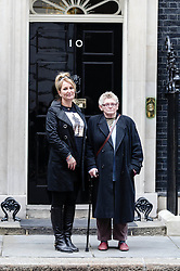 © Licensed to London News Pictures. 07/10/2012. London, UK. Caroline  Munday (LEFT) and Joan Humphreys (Right) stand in front of number 10 Downing Street having just delivered a letter to the Prime Minister asking that he withdraw British troops from Afghanistan by the end of the year.   This followed a protest against the war in Afghanistan held at Trafalgar Square by the Stop the War Coalition. Those who attended included Caroline Munday (mother of Trooper James Munday who was killed serving in Afghanistan in 2008), Joan Humphreys (grandmother of Private Kevin Elliott of the Blackwatch regiment who was killed serving in Afghanistan in 2009) Jeremy Corbin MP, Paul Flynn MP, Kate Hudsen of CND, musician Brian Eno, and John Rees of Stop the War.  Photo credit : Richard Isaac/LNP