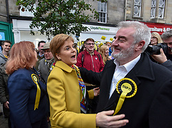 Pictured: Nicola Sturgeon greets SNP MP Tommy Shepherd.<br /> <br /> SNP leader Nicola Sturgeon campaigned in Leith, Edinburgh with SNP candidate for Edinburgh North and Leith Deirdre Brock.<br /> <br /> © Dave Johnston / EEm