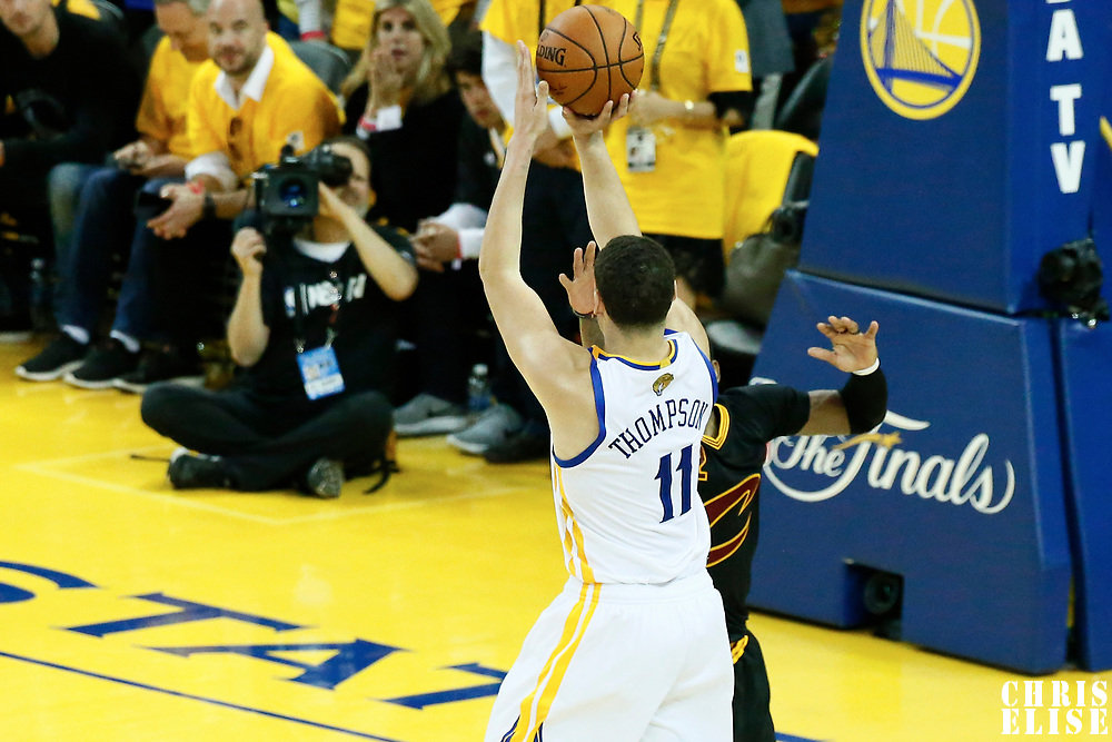 12 June 2017: Golden State Warriors guard Klay Thompson (11) takes a jump shot over Cleveland Cavaliers guard Kyrie Irving (2) during the Golden State Warriors 129-120 victory over the Cleveland Cavaliers, in game 5 of the 2017 NBA Finals, at the Oracle Arena, Oakland, California, USA.