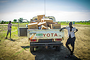 Medical supplies are loaded into the back of a pickup in Pibor, South Sudan. While AIM Air's focus is on supplying and supporting missionaries, they often are charted by other organizations to supply medical relief, food, and emergency evacuations.
