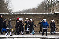 © Licensed to London News Pictures. 01/03/2018. London, UK. A group of Orthodox Jewish children in fancy dress celebrate the festival of Purim on the streets of Stamford Hill in north London on March 1, 2018. Purim celebrates the miraculous salvation of the Jews from a genocidal plot in ancient Persia, an event documented in the Book of Esther. Traditionally the jewish community wear fancy dress and exchange reciprocal gifts of food and drink. Photo credit: Ben Cawthra/LNP