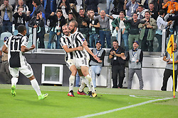 September 27, 2017 - Turin, Piedmont, Italy - Gonzalo Higuain (Juventus FC, left) celebrates with Giorgio Chiellini after scoring during the UEFA Champions League (Group D) football match between Juventus FC and Olympiakos FC  at Allianz Stadium on 27 September, 2017 in Turin, Italy. .Juventus won 2-0 over Olympiakos. (Credit Image: © Massimiliano Ferraro/NurPhoto via ZUMA Press)