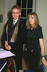 Rock musician ROGER TAYLOR and his former wife MRS DOMINIQUE TAYLOR, at a party in London on October 16th 1997.MCD 9