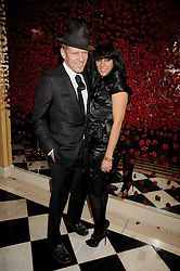 PAUL SIMONON and SERENA REES at a party to celebrate the 10th Anniversary of Claridge's Bar, Claridge's Hotel, Brook Street, London on 11th November 2008.