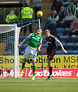 27th August 2017, Dens Park, Dundee, Dundee; Scottish Premier League football, Dundee versus Hibernian; Hibernian's Anthony Stokes and Dundee's Kevin Holt compete for the ball