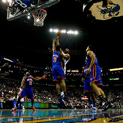 December 3, 2010; New Orleans, LA, USA; New Orleans Hornets center D.J. Mbenga, of the Democratic Republic of Congo, (28) shoots over New York Knicks small forward Shawne Williams (3) during the first half at the New Orleans Arena. Mandatory Credit: Derick E. Hingle