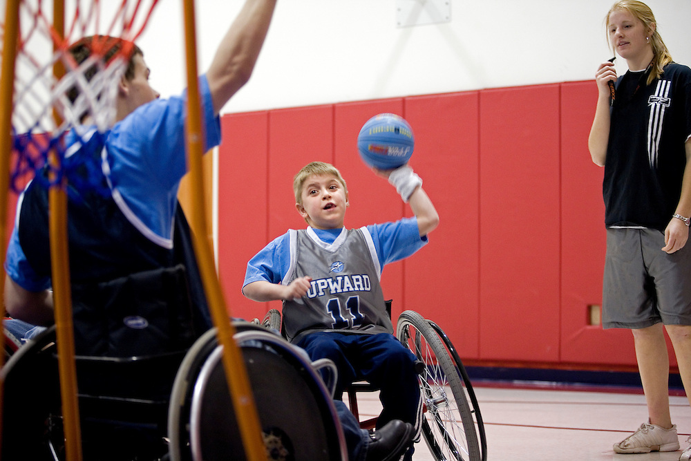 "Kellogg Foundation Assignment: Wheelchair Basketball..Hunter Sebring shoots the ball...The contact is Pam Patula, 888/957-6245 runs an organization.called Socil (S.E. center for Independent Living )a member of April.  A weekly wheelchair basketball game in Lancaster, held on Jan 20th. Saturday at 10am. The basketball coach, Brett Harbage, is an Independent Living Specialist from SOCIL.  Other coach is Cheryl ""Hutch"" Hutchinson, she is the adaptive physical education instructor of Fairfield County.  The adaptive basketball games are part of the Upward Basketball league, .  This is only Upwards adaptive league in the nation."