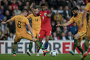 Marcus Rashford (England) steps inside Bailey Wright (Australia) with Mile Jedinak (Australia) closing in on him during the Friendly International match match between England and Australia at the Stadium Of Light, Sunderland, England on 27 May 2016. Photo by Mark P Doherty.