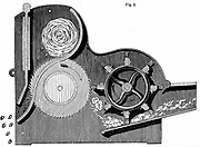 Cross-section of Elihu Whitney's (1765-1825) saw-gin for cleaning cotton.  Seeds can be seen ejected on left, while cotton fibres are passing on right. Wood engraving 1865.