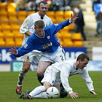 St Johnstone v Falkirk...03.04.04<br />Mark Baxter tackles Craig McPherson<br /><br />Picture by Graeme Hart.<br />Copyright Perthshire Picture Agency<br />Tel: 01738 623350  Mobile: 07990 594431