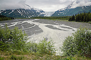 Terminus of Exit Glacier in Alaska with moraine and braided River. Clouds Obscure Sky