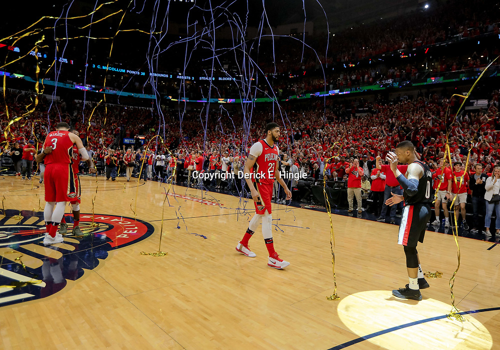 Apr 21, 2018; New Orleans, LA, USA; New Orleans Pelicans forward Anthony Davis (23) walk up to Portland Trail Blazers guard Damian Lillard (0) as confetti falls to the floor following the Pelicans win and sweep of the series after game four of the first round of the 2018 NBA Playoffs at the Smoothie King Center.  Pelicans defeated the Trail Blazers 131-123 sweeping the series and advancing to the western conference semi-finals.  Mandatory Credit: Derick E. Hingle-USA TODAY Sports