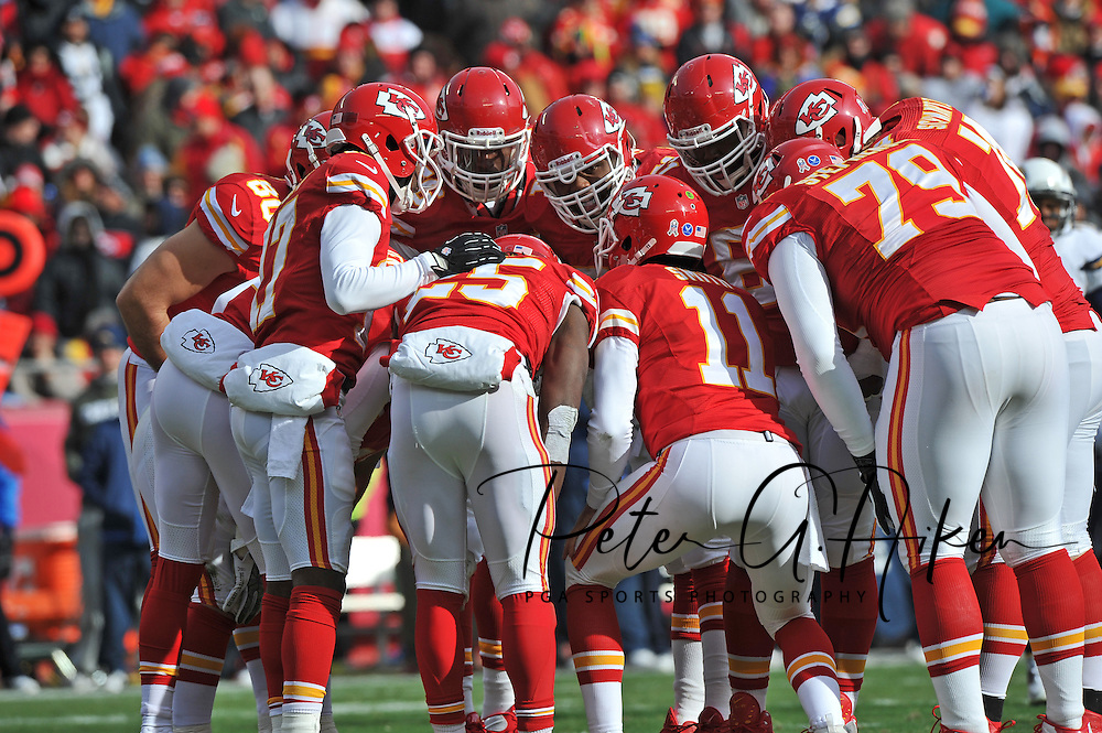 KANSAS CITY, MO - NOVEMBER 24:  Quarterback Alex Smith #11 of the Kansas City Chiefs calls out a play in the huddle against the San Diego Chargers during the first half on November 24, 2013 at Arrowhead Stadium in Kansas City, Missouri. (Photo by Peter G. Aiken/Getty Images) *** Local Caption *** Alex Smith