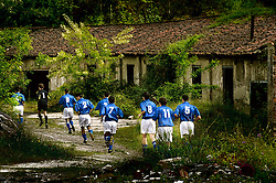 Asturias,Spain.Football field in Blimea, a small village in the north of Spain.The players are running to the field before the game.© Carmen Secanella.