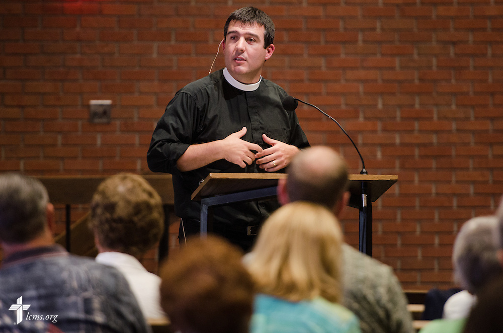 The Rev. Bryan Wolfmueller, pastor of Hope Lutheran Church in Aurora, Colo., leads a keynote address in St. John Lutheran Church at the 2014 Institute on Liturgy, Preaching and Church Music on Tuesday, July 29, 2014, near Concordia University, Nebraska, in Seward, Neb. LCMS Communications/Erik M. Lunsford