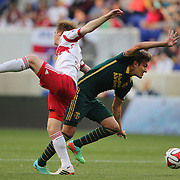Maximiliano Urruti, (right). Portland Timbers, wins the ball in a challenge with Dax McCarty, New York Red Bulls, during the New York Red Bulls Vs Portland Timbers, Major League Soccer regular season match at Red Bull Arena, Harrison, New Jersey. USA. 24th May 2014. Photo Tim Clayton