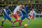 Tom Pett (Stevenage) stopped by two Hartlepool defenders during the Sky Bet League 2 match between Hartlepool United and Stevenage at Victoria Park, Hartlepool, England on 9 February 2016. Photo by Mark P Doherty.
