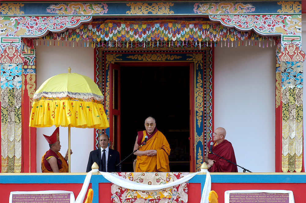 His Holiness the Dalai Lama addressing the public from the stupa at the Vajradhara Ling Buddhist Temple in Normandie during his His Holiness' visit to France. The Dalai Lama blessed a project to build a Temple for Peace at the center and gave a speech to hundreds of guests...Aubry-le-Panthou, France. 14/08/2008..Photo © J.B. Russell