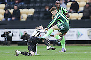 Jake Reeves of AFC Wimbledon is sent flying by Elliott Hewitt of Notts County during the Sky Bet League 2 match between Notts County and AFC Wimbledon at Meadow Lane, Nottingham, England on 23 January 2016. Photo by Stuart Butcher.